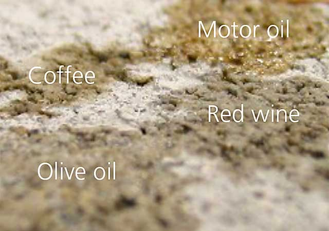 Stains of motor oil, olive oil, red wine and coffee on untreated concrete